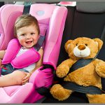 Image of smiling baby girl in carseat