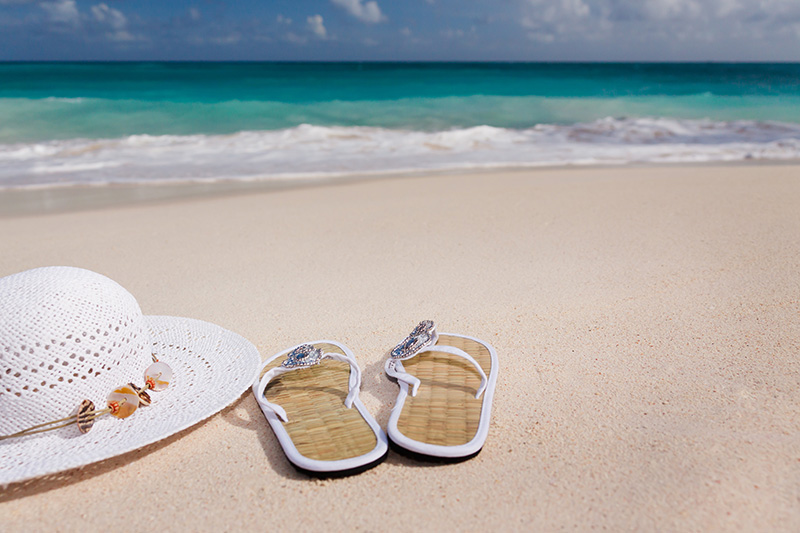Relieve Stress At The Beach - Image of Hat and Sandals